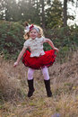 Happy girl in the countryside young vintage clothes jumping for joy Royalty Free Stock Photo