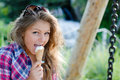 Happy girl eating ice cream outdoors Stock Photos
