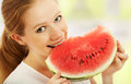 Happy girl eats the watermelon Royalty Free Stock Image