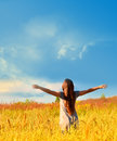Happy girl enjoying the happiness on sunny meadow free enjoys and freedom nature Stock Photography