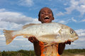 Happy girl with fish, Madagascar Royalty Free Stock Photo
