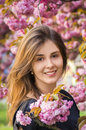 Happy girl in the flowers of sakura portrait beautiful Royalty Free Stock Photos