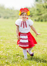 Happy girl in folk clothes