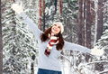 Happy girl in a forest winter Royalty Free Stock Photos