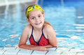 Happy girl with goggles in swimming pool Royalty Free Stock Image