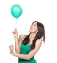 Happy girl with green balloon as a present for birthday party young smiling on white background Royalty Free Stock Photography