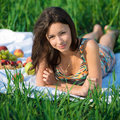 Happy girl on green grass Royalty Free Stock Photo
