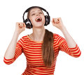Happy girl having fun listening to music on headphones Stock Photos