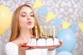 Happy girl and her birthday cake Royalty Free Stock Photo