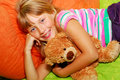 Happy girl with her teddy bear Stock Photo