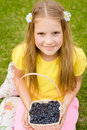 Happy girl holding basket with berry Royalty Free Stock Photo