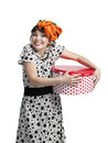 Happy girl holding gift box with red polka dots young in a dot dress and bow on her head on a white background Stock Image