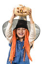 Happy girl holding halloween pumpkin over her head isolated on white Royalty Free Stock Image