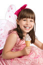 Happy girl holding ice cream in hand Stock Image