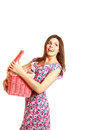 image photo : Happy girl holding an open laundry basket on white background