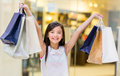 Happy girl holding shopping bags mall Stock Photos