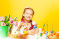 Happy girl holds pail with tulips and rabbit near pink eastern eggs cute on the table the yellow background Royalty Free Stock Images