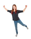 Happy girl jumping with arms extended Royalty Free Stock Photo