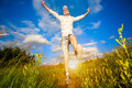Happy girl jumping over the blue sky Royalty Free Stock Image