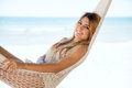 Happy girl laying in a hammock at the beach Royalty Free Stock Photo