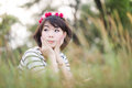Happy girl lies among the wild flowers on a summer evening Royalty Free Stock Photos