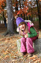 Happy girl little in autumn park Stock Photos