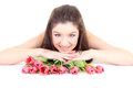 Happy girl lying with pink tulips Royalty Free Stock Image