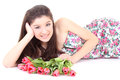 Happy girl lying with pink tulips Stock Photo