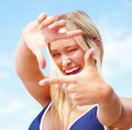 Happy girl making hand gesture Royalty Free Stock Images