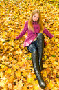 Happy girl on maple leaves Stock Photo