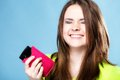 Happy girl with mobile phone in pink cover Royalty Free Stock Photo