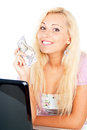 Happy girl with money and laptop isolated Royalty Free Stock Images