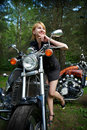 Happy girl and motorcycle Royalty Free Stock Image