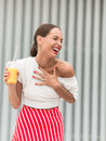 Happy girl with orange juice cocktail Royalty Free Stock Photo