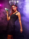 Happy girl on a party beautiful with drink in nightclub Stock Photo
