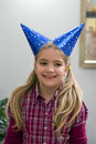 Happy girl in party hats Stock Image