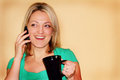 Happy girl on phone holding mug Stock Images