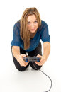 Happy girl playing video games on the joystick