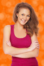 Happy girl portrait of with healthy skin posing orange Royalty Free Stock Photos