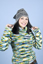 Happy girl  in pullover and wool cap Stock Images