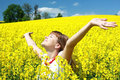 Happy girl in the rapeseed field Royalty Free Stock Photo