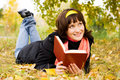 Happy girl reading a book Royalty Free Stock Image