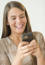 Happy girl reading text message on smart phone closeup of teenage Stock Photography