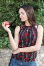 Happy girl with red apple Stock Image