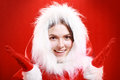 Happy girl in santa cloth exited on red christmas background Royalty Free Stock Photos