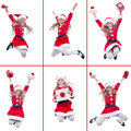 Happy girl with santa costume jumping holding various holidays items isolated Stock Photography