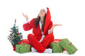 Happy girl in santa costume waiting a snow Stock Photo