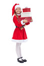 Happy girl in santa outfit holding presents little isolated Stock Images