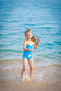Happy  girl in the sea. Fun with water drops Stock Image