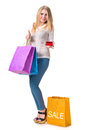 Happy girl with shopping bags and credit card Stock Image